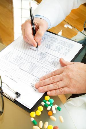 Doctor writing prescription selective focus