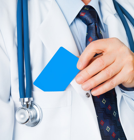 Closeup of business card in doctor
