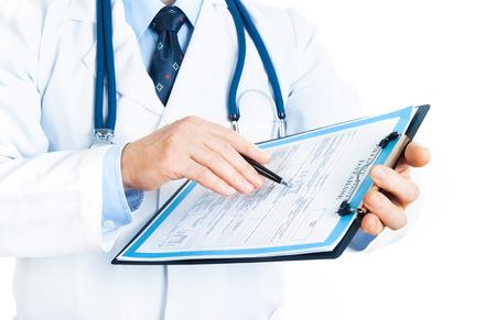 doctor writing: doctor writing a prescription