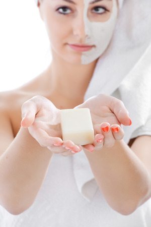 Spa woman isolated - clean skin with mask and lather, soap in hands