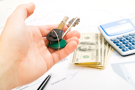 young business man giving key and account money photo
