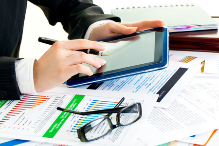 woman tablet pc: young business woman hands in office holding tablet pc