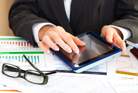 business woman with tablet: young business woman hands in office holding tablet pc