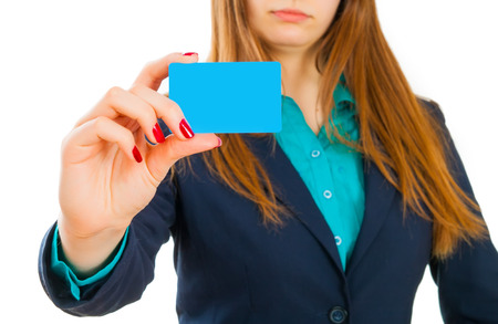 Businesswoman in suit holding a blank card photo