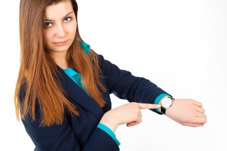 watch over: angry business woman pointing her watch over white background Stock Photo