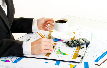 break in: Accounting. Business woman hands in office. Coffee break Stock Photo