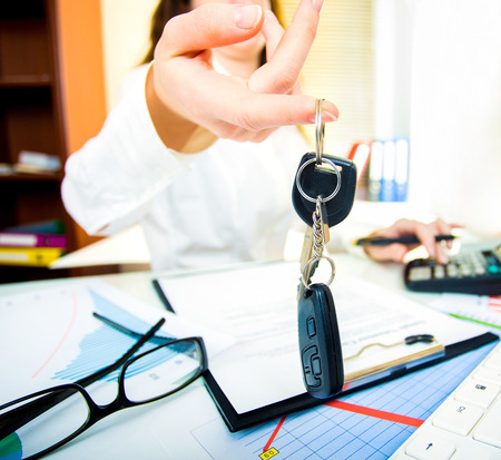 A woman hand with car keys. Rent car deal