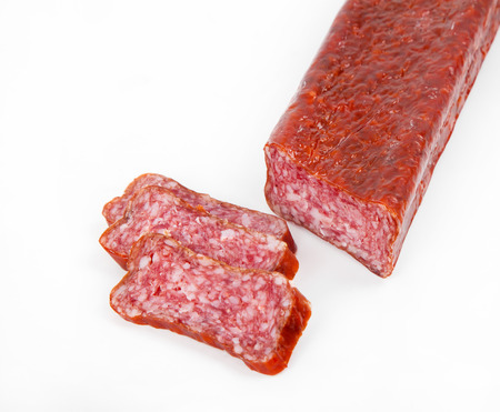 italian salami: Slices italian salami sausage on white background Stock Photo