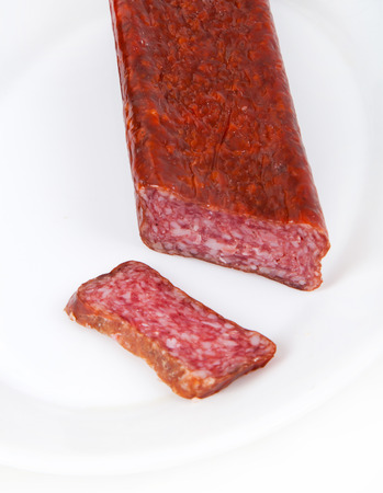 italian salami: Slice italian salami sausage on white background