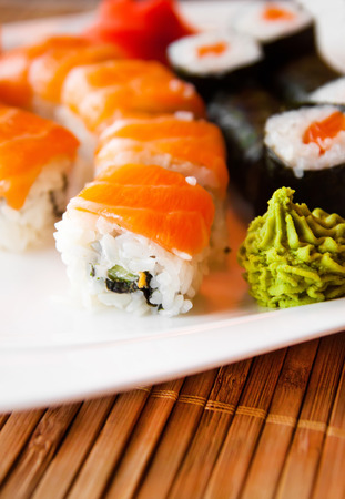 fish dish: Roll with Cream Cheese and Cucumber inside. Salmon topped Stock Photo