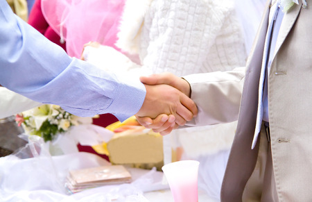 a meeting with a view to marriage: Closeup of Handshake on wedding