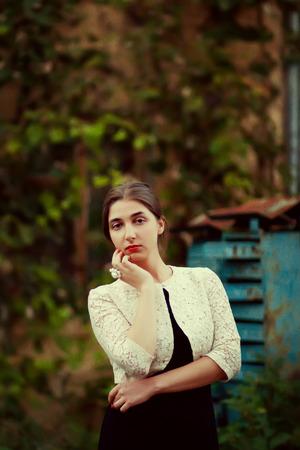 melancholijny: Melancholic woman in classic dress near old brick wall outdoor shot summer day. Toning photo