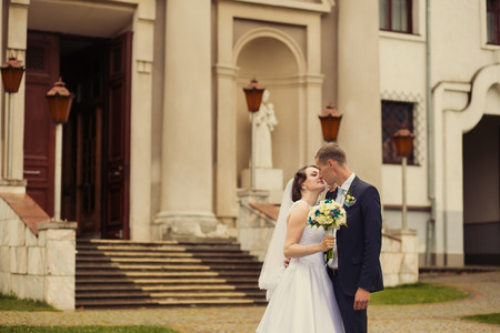 Wedding couple near old building Stock Photo