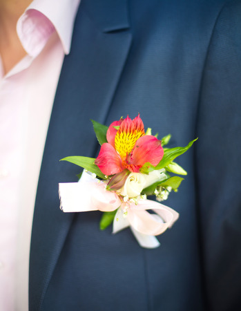 boutonniere: boutonniere flower on a groom