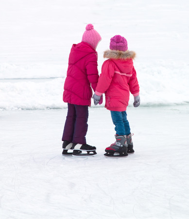 iceskating: children with ice skates on winter ice Stock Photo