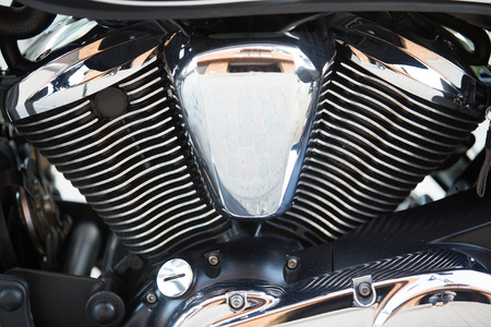 chromium plated: Shiny chromium-plated motorcycle engine closeup photo