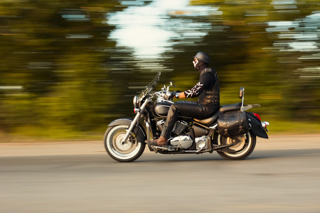 slow motion, biker riding motorbike with blur movement, speed concept photo