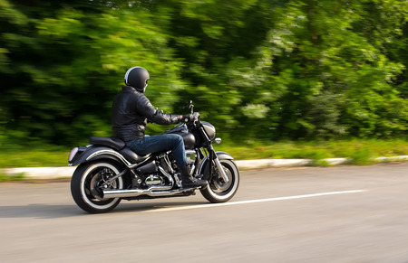 slow motion, biker riding unknown motorbike with blur movement, speed concept photo