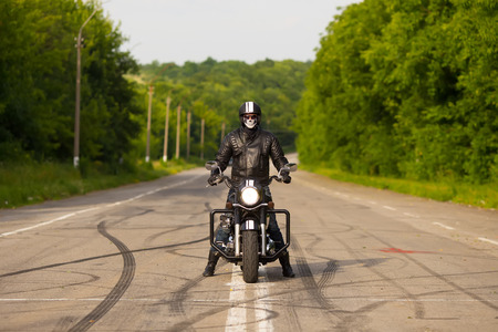 slow motion, biker riding unknown motorbike with blur movement, speed concept