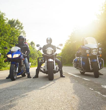 bikers sitting on their bikes, big chopper bike, sport bike on road Imagens