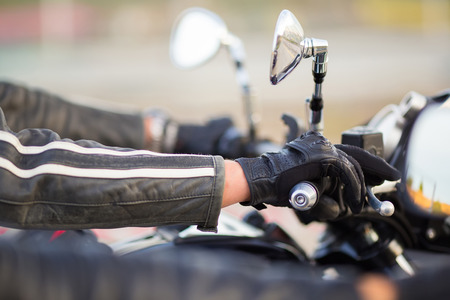 Biker hand rests on the steering wheel motorcycle