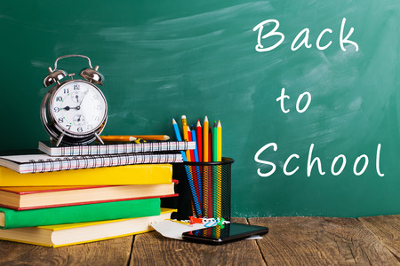 Back to school supplies. Books and blackboard.