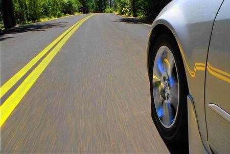 Speeding Car on Road Stock Photo