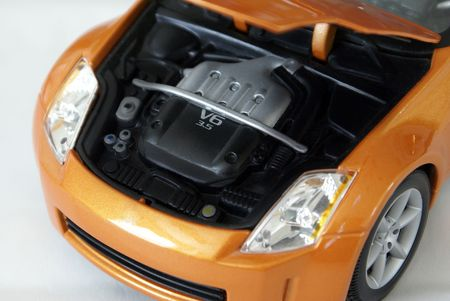 New sports car with hood open, powerful engine.