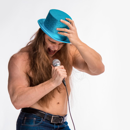 druid: singer bodybuilder shirtless with long hair in a blue hat with a microphone on a white background