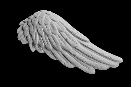 white plaster wings on a black background Reklamní fotografie