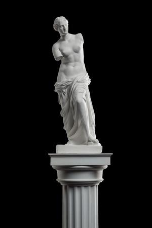 a statue of Venus, plaster column on a black background Фото со стока