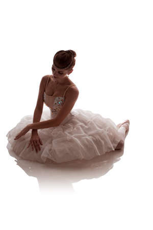 """woman ballerina in white pack posing on white background photo made in the style of """"low key"""""""