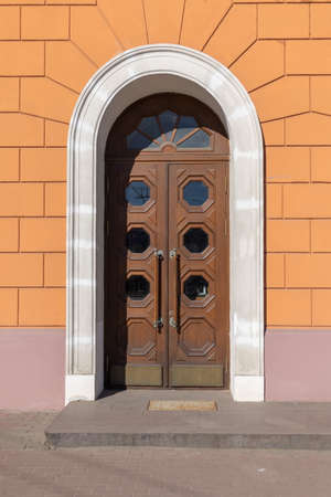 Elements of architectural decoration of ancient buildings, an old door and lattice gate, doorway and arch. On the streets in Minsk, public places.