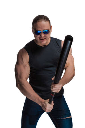 Portrait of a brutal man bodybuilder in sunglasses with a baseball bat on a white background 写真素材