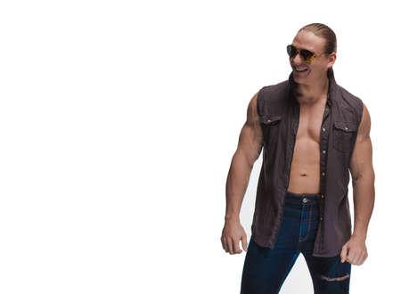 Portrait of a brutal man bodybuilder model on a white background