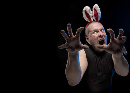 Comic actor with bunny ears, on the eve of Christmas and New Year