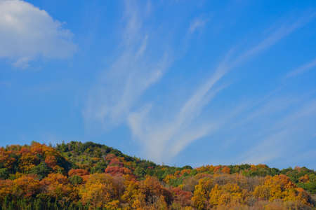 Late autumn sky and mountains Stock Photo