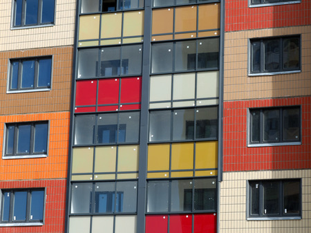 double glazing: New house, new building. Bright, multi-colored blocks walls, new windows - background, texture Stock Photo