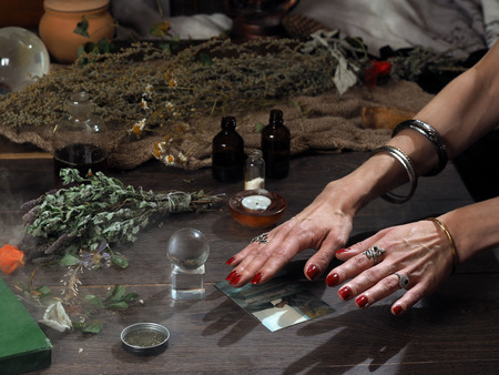 otherworldly: Work hereditary Sage. Find people on photos. Hands witch. working table magician. Photo missing person. The magic transparent sphere. Many medicinal herbs. Magic, estransensorika, occult, magic