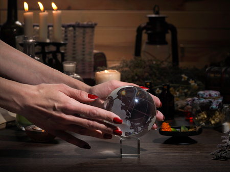healing process: Hands witch. Transparent sphere. Magical objects and utensils of the alchemist. Candles, herbs. Concept - alternative medicine, witchcraft and the occult. Halloween. Divination, sorcery. Work Healer