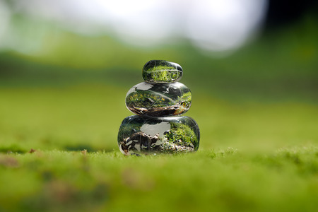 green world: Transparent stones on a green moss. Concept - peace of mind. Environment. The harmony of the inner world