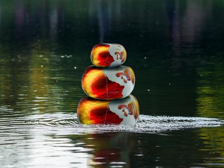 Resplandeciente fuego piedras voluminosos en el agua. Zen pirámide. Concepto - el estrés, el yoga, la meditación, el Zen Foto de archivo