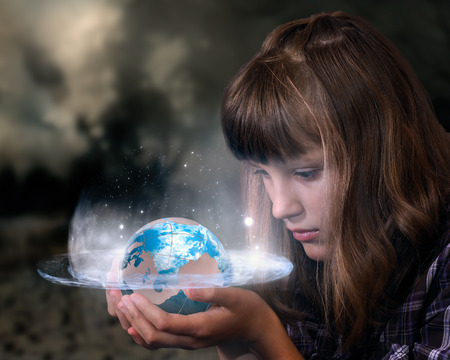 Girl holding a glowing planet earth. The concept of ecology, climate, destruction, the future of humanity