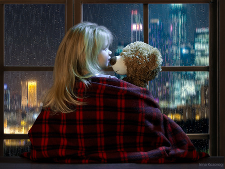 bedtime story: Little girl talking with a toy bear in the window. Outside, the city, rain, night