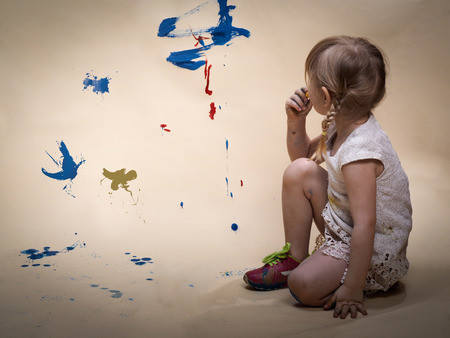 expressionism: Concept - child development, creativity, the study of abstract painting. The child sees colorful abstract smears of paint. Vintage, retro
