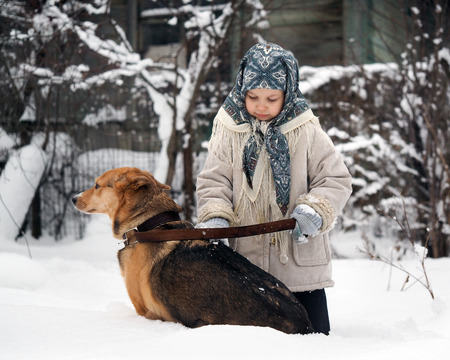 mittens: The little girl shakes mittens snow dogs Stock Photo