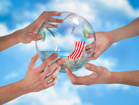 Hands supporting a transparent globe. Within the sphere of the beach, sea, palms, yacht, sun lounger. The background of blue sky. The concept of wish fulfillment, dreams of vacation, loans for travel, Imagens