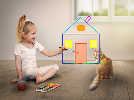 apartment for rent: child draws a house with bright colors. The cat is watching. The concept of their housing, lending and insurance of real estate Stock Photo