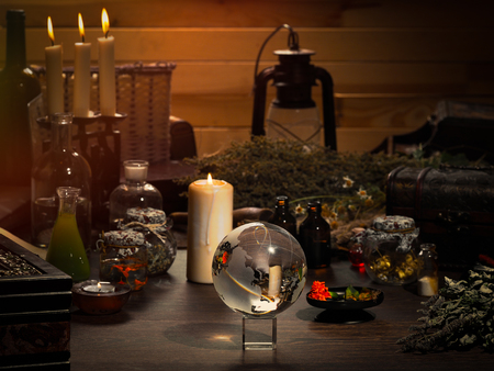Mystical still-life. Magic ball, dry herbs, all for magical rituals. A lot of items. Candles Stock Photo