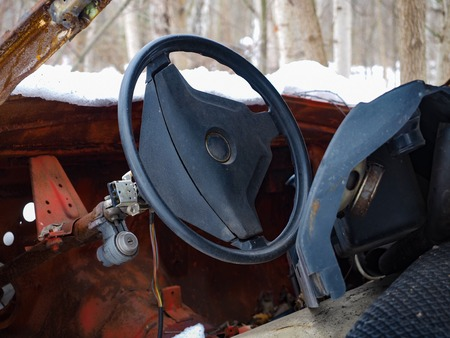 salvage yards: Old red car rusts under a layer of snow Stock Photo